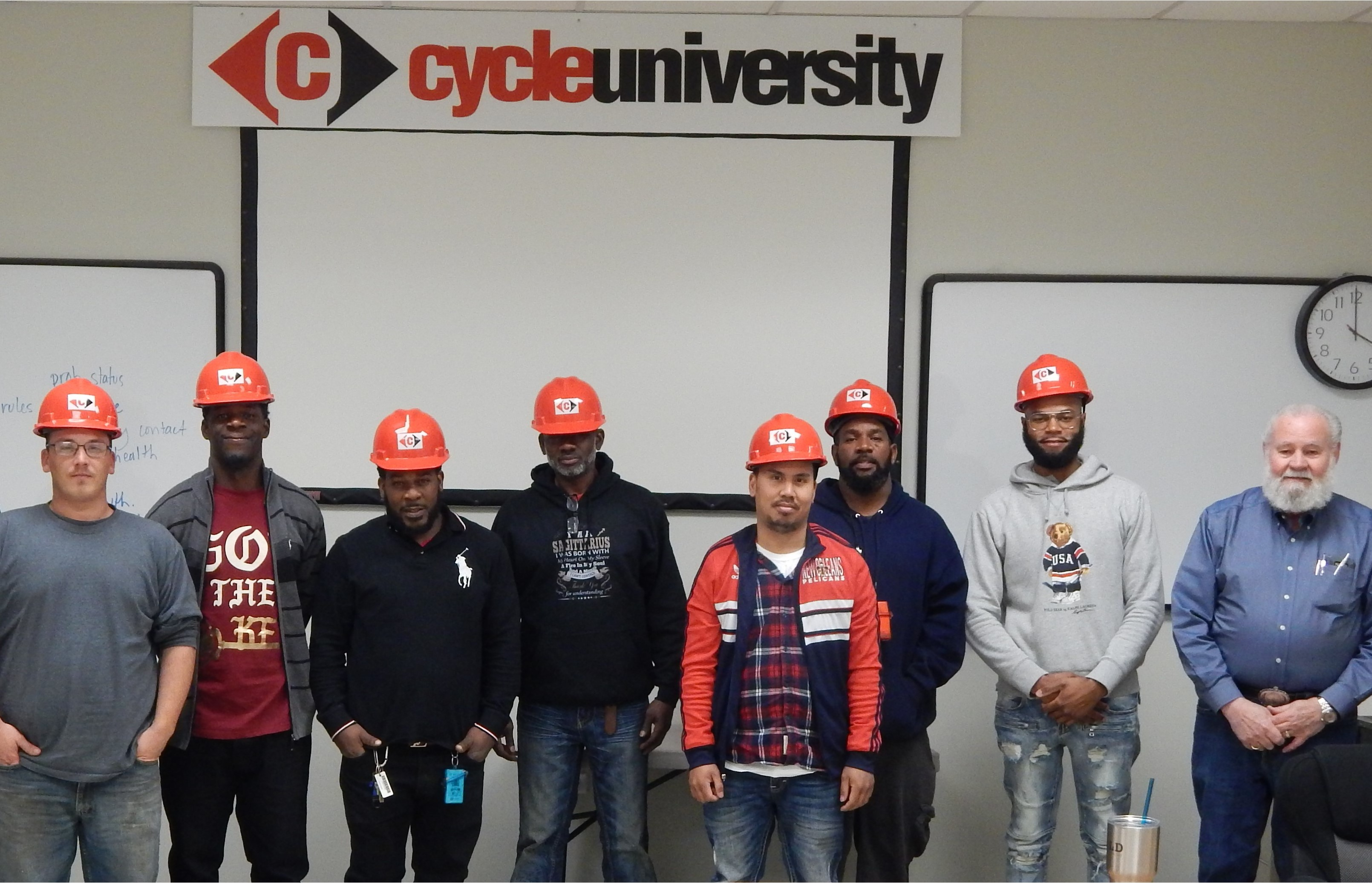 Men presented with red hard hats